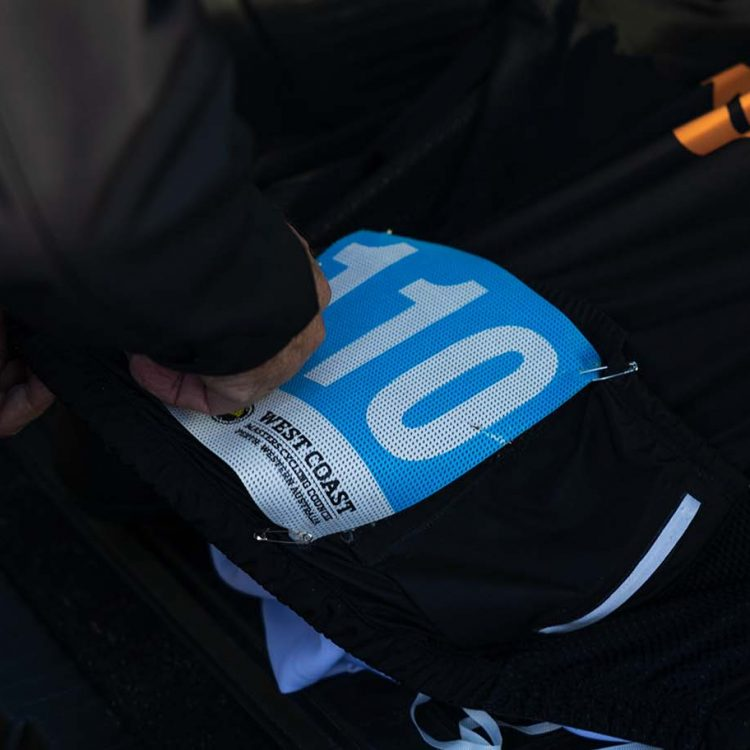 A close up of a rider-'s racing number